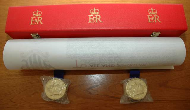 The scroll and its presentation box